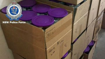 Some of the 4000 tins of baby formula found during a police raid last year.