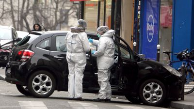 Forensic experts examine the car believed to have been used as the escape vehicle by the masked gunmen.<br><br>The French interior minister said three attackers took part in the shooting. (AAP)