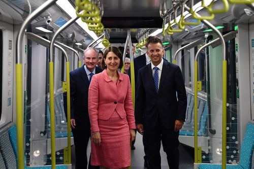 New South Wales Premier Gladys Berejiklian (centre), Minister for Transport Andrew Constance (right) and Member for Riverstone Kevin Conolly (left) take the first ride on a Sydney Metro train from Tallawong to Norwest in Sydney. (AAP Image/Dean Lewins)