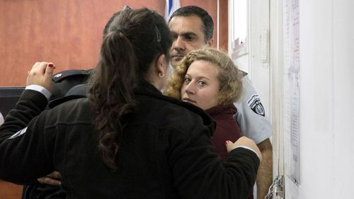 Palestinian Ahed Tamimi Is escorted at a military court near Jerusalem