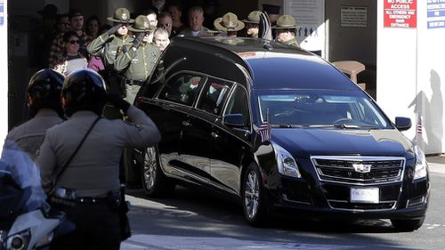 A police procession was today held in the streets of Thousand Oaks for sergeant Helus as his body was transported from the hospital.