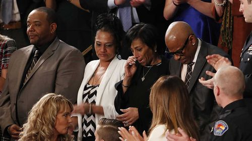 Robert Mickens, Evelyn Rodriguez Elizabeth Alvarado and Freddy Cuevas react as US President Donald J. Trump talks about the murder of their daughters. (AAP)