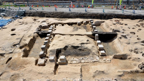"This undated photo provided by Osaka City Cultural Properties Association shows the foundation of a structure at the ""Umeda Grave"" burial site in Osaka, western Japan. The photo was taken during the cemetery research between Sept. 2019 and Aug. 2020."