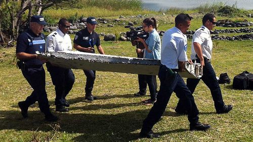 French authorities with the MH370 flaperon,