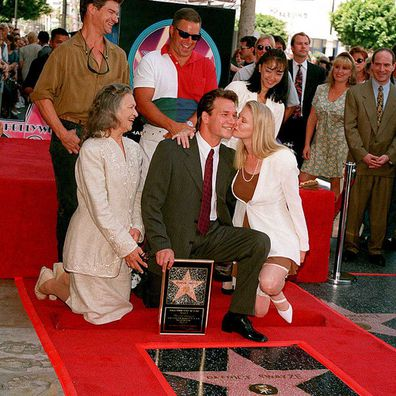 Patrick Swayze pictured with his mother, Patsy Swayze(left), and wife Lisa Niemi (right) as he gets a star on the Hollywood Walk of Fame