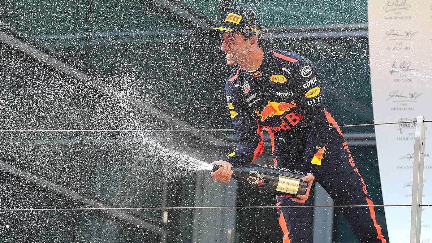 Australian F1 driver Daniel Ricciardo of Red Bull Racing sprays champagne