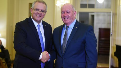 Australian Prime Minister Scott Morrison (left) shakes hands with Australian Governor-General Sir Peter Cosgrove during a swearing-in ceremony on Friday.