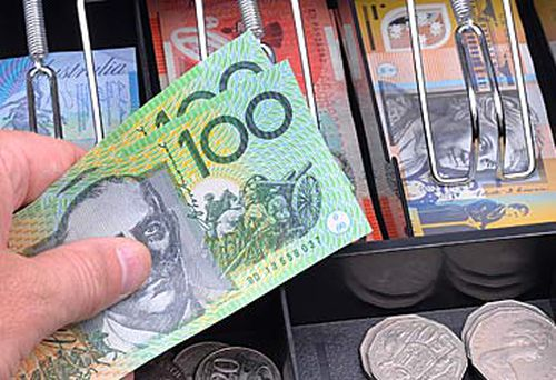 Money in cash register (Getty)
