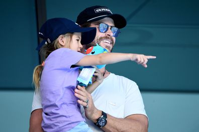 Actor Chris Hemsworth and daughter India Rose Hemsworth attend the swimming on day three of the Gold Coast 2018 Commonwealth Games at Optus Aquatic Centre on April 7, 2018 on the Gold Coast, Australia.