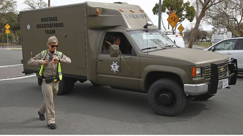 Negotiations teams and heavily-armoured police were called into the Veterans home during the standoff (AAP).
