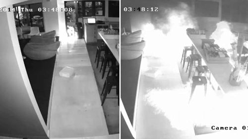 CCTV has captured the moment two arsonists set St Kilda restaurant Republica on fire. (Supplied)