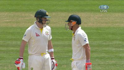 Warner confers with Smith