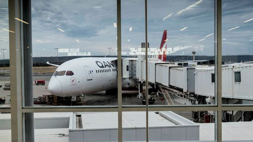 A file photograph shows the new Qantas Dreamliner 787-9 at the Perth International terminal ahead of its first direct flight to Heathrow.
