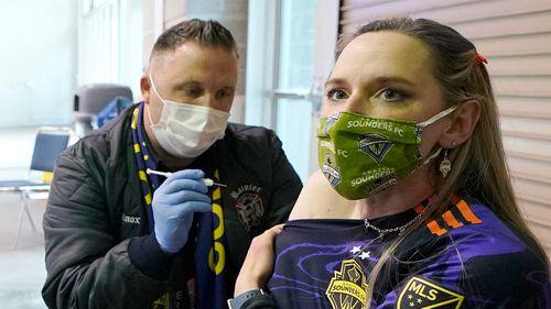 A soccer fan gets a Moderna vaccine ahead of an MLS game in Seattle.