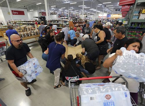 Residents purchase water at BJ Wholesale in preparation for Hurricane Irma in Miami. (AP)