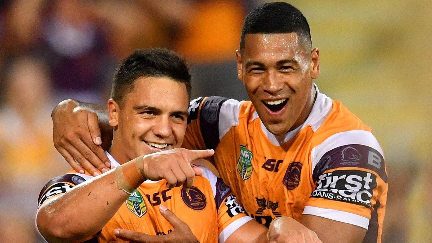Kodi Nikorima of the Broncos celebrates scoring a try with Jamayne Isaako