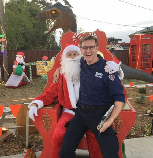 A firemen posing for a photograph with Santa outside the family's house (A Current Affair)