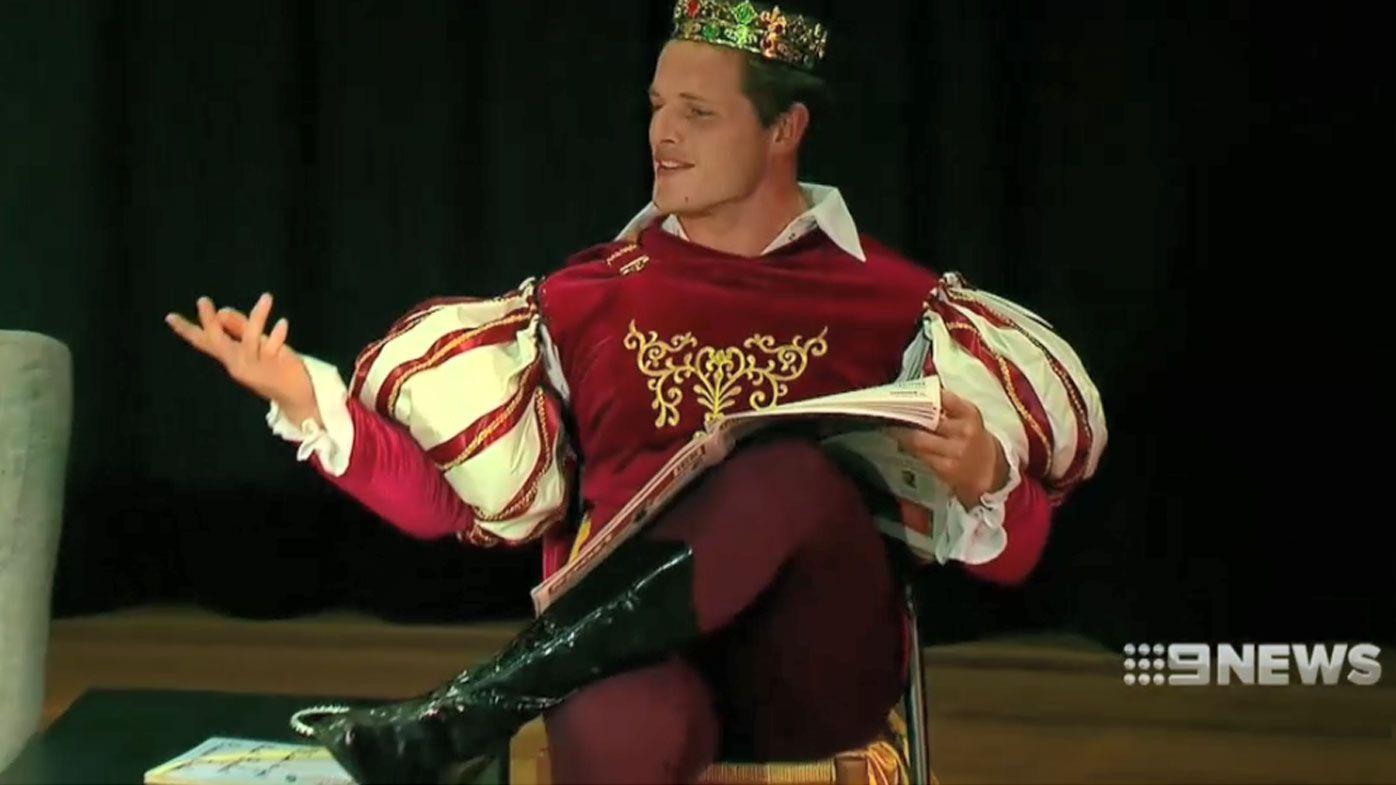 George Burgess performs on stage