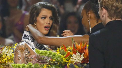 Iris Mittenaere is overcome with joy as she is crowned Miss Universe. (AAP)