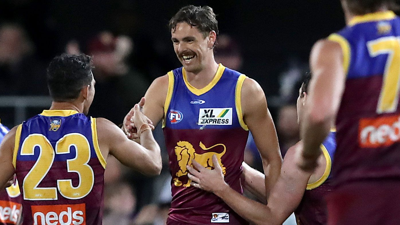 Joe Daniher of the Lions celebrates a goal during the round five AFL match between the Brisbane Lions and the Essendon Bombers at The Gabba on April 17, 2021 in Brisbane, Australia. (Photo by Jono Searle/AFL Photos/via Getty Images )