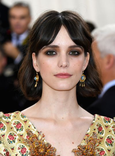 Stacy Martin's heavy, smokey eye works perfectly with her lightly-tousled, second-day hair do for a boudoir-inspired look.