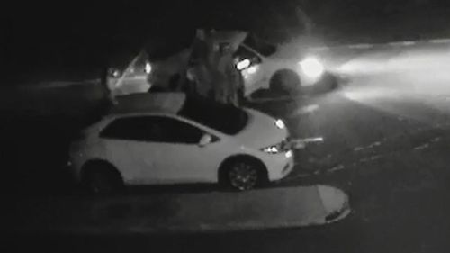 A man was pulled from the car and kicked unconscious, while a woman in the car was also allegedly sexually assaulted. (9NEWS)