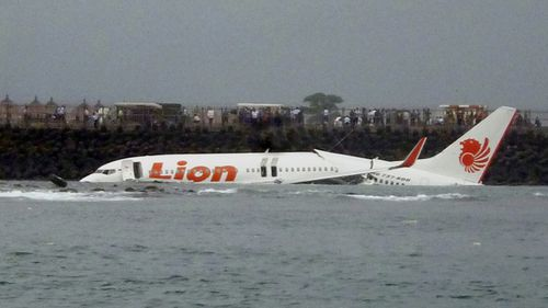 A crashed Lion Air plane is seen near the coastline of Bali's Ngurah Rai International Airport, Bali, Indonesia, 14 April 2013.