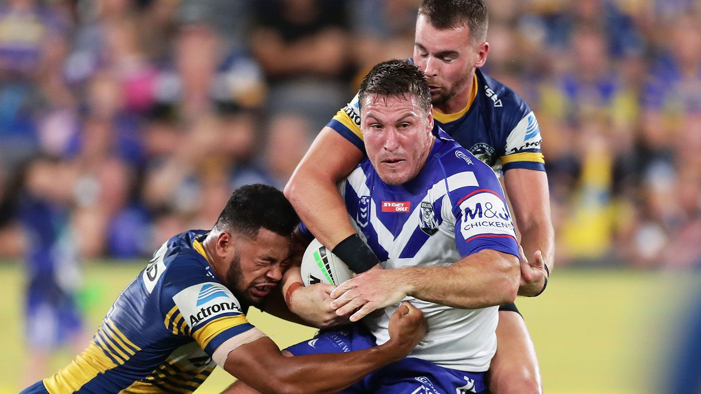 Josh Jackson of the Bulldogs is tackled during the round 1 NRL match between the Parramatta Eels and the Canterbury Bulldogs
