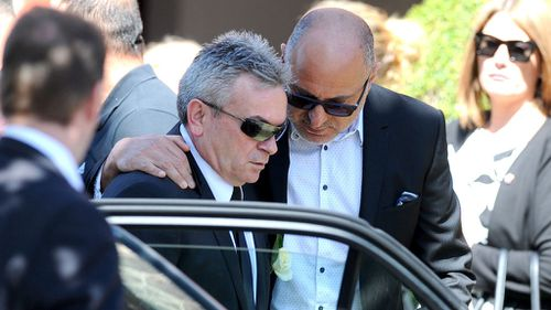 Mr Ristevski attending his wife's funeral.
