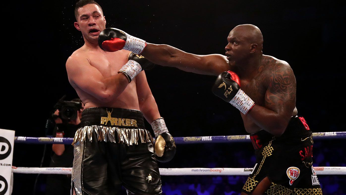 Dillian Whyte (right) lands a punch against Joseph Parker