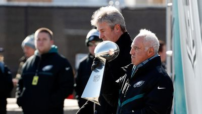 Philadelphia Eagles owner Jeffrey Lurie holds the Vince Lombardi trophy with head coach Doug Pederson, behind left. (AAP)
