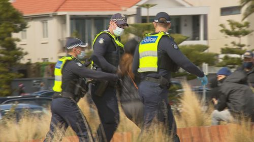 """Protesters chanted slogans like """"together, united, we'll never be divided"""" and at least a dozen arrests were made, according to The Age."""