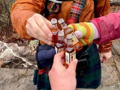 A picture of four men sharing a drink while on a bushwalk has left readers scratching their heads.