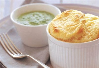 Goat cheese soufflé with creamed spinach sauce