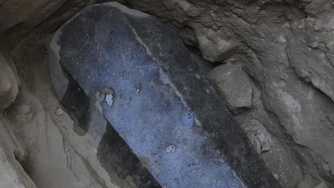 Archaeologists have discovered a black grainite sarcophagus in an ancient cemetery deep underneath Alexandria Egypt