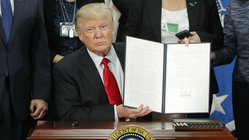 Mr Trump has signed an executive order to begin construction on the border wall. (AAP)