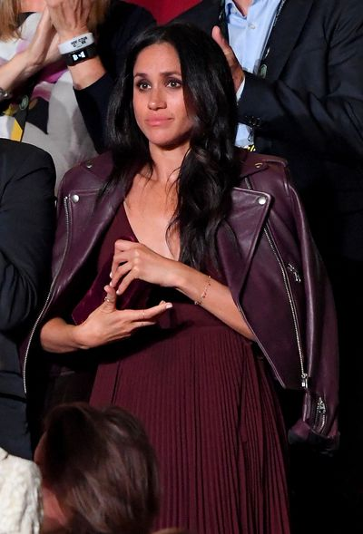 "<p>Prince Harry's GF actress Meghan Markle stepped out in a mid-length maroon dress and damn if we don't now all want one. The US $185 dress, from <a href=""http://intl.aritzia.com/product/beaune-dress/61870.html?dwvar_61870_color=2346"" target=""_blank"">Aritzia's in-house label Wilfred</a>, featured a pleated skirt and wrapped bodice with sweet spaghetti straps - and it's still available!</p> <p>The always chic Meghan topped the look off with an ox-blood leather biker jacket from the label Mackage and a velvet clutch in a matching plum shade. We were so inspired we figured we'd pull together a handy shopping guide to all things maroon.</p> <p>Click through for royal colour block inspiration.</p> <p> </p>"