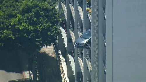 Car teeters off fourth floor of Santa Monica car park. Picture: Supplied