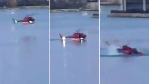 A bystander captured the moment the helicopter plunged into the water and below the surface. (Supplied)