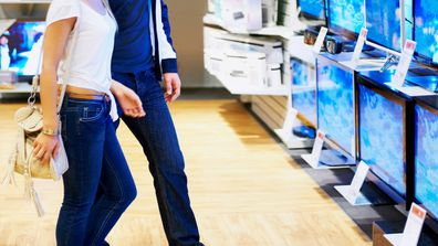 Young couple shopping for electronics on sale