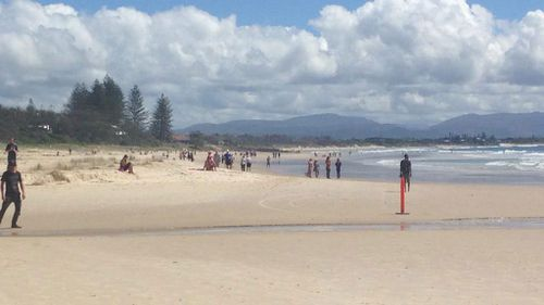 A doctor on Byron Bay's Main Beach was unable to save a man believed to have been attacked by a shark. (9NEWS)