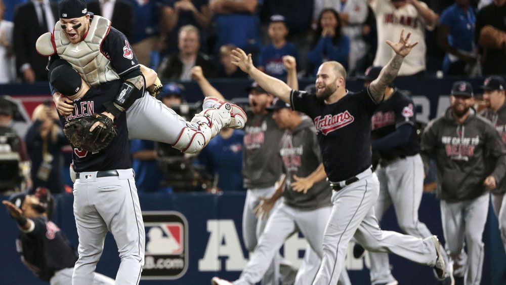 Cleveland Indians celebrate after defeating Toronto to make the major League World Series.(AAP)