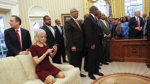 Counselor to the President Kellyanne Conway sat on the couch in the Oval Office during a presidential meeting on Feb. 27, 2017. Photo: AP