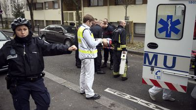 "Firefighters carry an injured man on a stretcher in front of the offices of the newspaper Charlie Hebdo.  <br><br> The massacre at the French weekly took place after years of confrontation between the satirical publication and Islamists infuriated by what they see as its attacks on their religion. <br><br> Its offices were fire-bombed in November 2011 when it published caricatures of the Muslim prophet Mohammed but there were no casualties in that attack. <br><br> Its latest issue's front page highlighted yet another polemic about Islam, with a focus on controversial French author Michel Houellebecq and his latest book, ""Soumission"" (""Submission""), which imagines a France in 2022 under Muslim rule. <br><br> (Getty Images)"