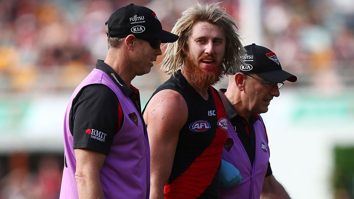 Essendon skipper Dyson Heppell assisted from field as Bombers down wasteful Brisbane Lions