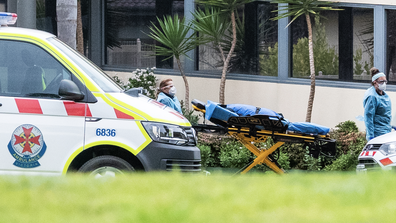 Ambulance service workers push a stretcher into the St Basil's homes for the Aged facility in Fawkner on July 27, 2020 in Melbourne, Australia.