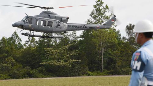A helicopter takes off to assist in the search. (Getty Images)