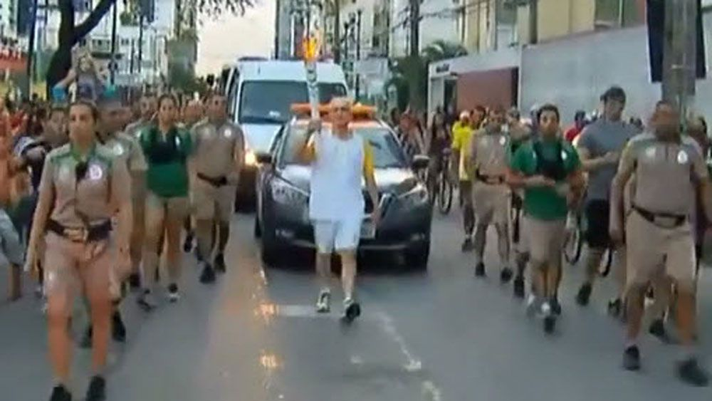 Brazil icon takes a tumble with Olympic torch