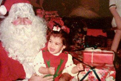 Years before it broke the Internet, Kim's butt was planted firmly in Santa's lap in this Xmas shot.