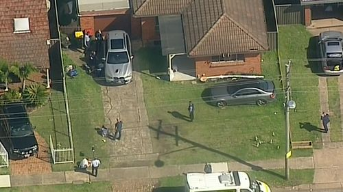 Three people have been arrested in Sydney's west over a body found in a burnt-out tent in Geelong.
